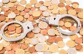 stock photo of cony  - Picture of a Business Money Concept Idea Conis and Handcuffs - JPG