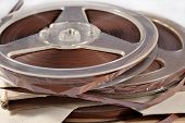 foto of magnetic tape  - Old vintage bobbins with magnetic tapes close up - JPG