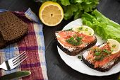 stock photo of butter-lettuce  - Homemade sandwich with salmon and rye bread  - JPG