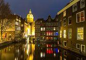 foto of nicholas  - Amsterdam Canals and Saint Nicholas church at dusk Natherlands - JPG