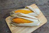 foto of corn-silk  - Organic dry brown corn, organic plant on the old wood table closeup shot ** Note: Shallow depth of field - JPG