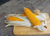 picture of corn-silk  - Organic dry brown corn, organic plant on the old wood table closeup shot ** Note: Soft Focus at 100%, best at smaller sizes - JPG