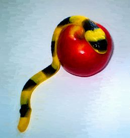 foto of serpent  - Jelly serpent crawling over an apple  - JPG