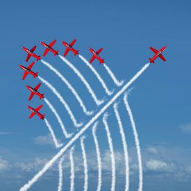 picture of leadership  - Disruptive innovation Independent leadership concept and individuality as a group of acrobatic jets with one individual jet going in the opposite direction as a business symbol for new thinking and attitude as a different nonconformist maverick - JPG