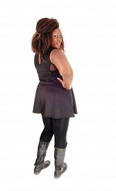 pic of tight dress  - A big African American woman in a black dress tights and boots standing from the back isolated for white background - JPG