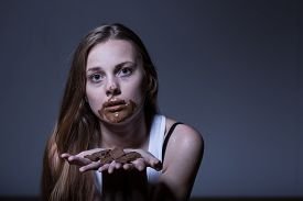 foto of bulimic  - Girl with eating disorder during bulimic attack - JPG