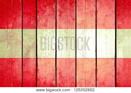 Austria wooden grunge flag. Austria flag painted on the old wooden planks. Vintage retro picture from my collection of flags.