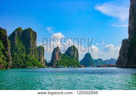 Floating fishing village near rock islands in Halong Bay, Vietnam, Southeast Asia