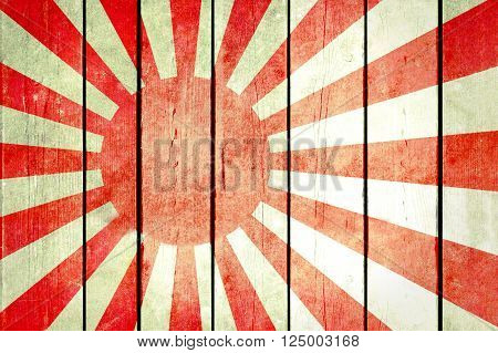 Imperial Japan wooden grunge flag. Imperial Japan flag painted on the old wooden planks. Vintage retro picture from my collection of flags.