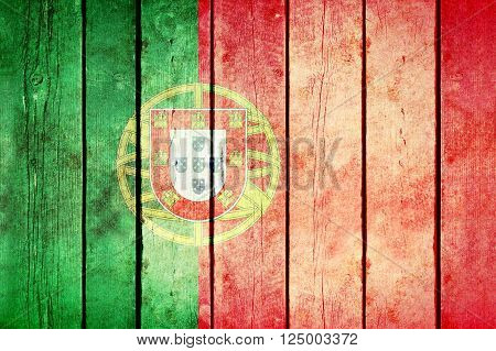 Portugal wooden grunge flag. Portugal flag painted on the old wooden planks. Vintage retro picture from my collection of flags.