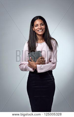Beautiful indian hispanic latino mixed race corporate business woman holding an  organiser