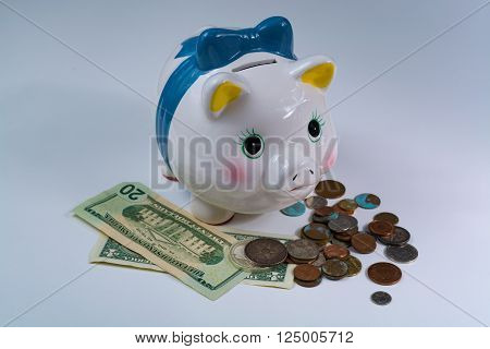 Piggy bank US dollars and coins - business concept isolated on white background
