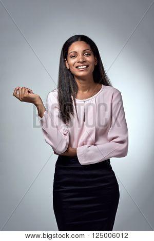 Smiling mixed race hispanic business woman in studio