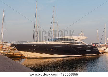 Black luxury yacht at the dock. Transport