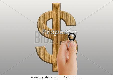 Isolated Hand With Lens On Platinum Background With Dollar Sign And Text Property