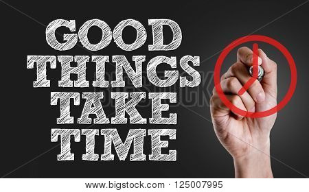 Hand writing the text: Good Things Take Time