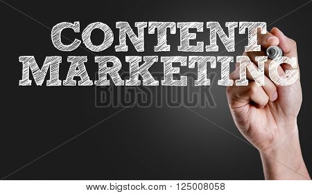 Hand writing the text: Content Marketing