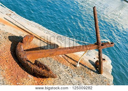 Old big rusty anchor on the pier in Portovenere Liguria Italy