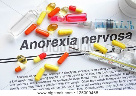 Medicines and Anorexia diagnosis written on paper closeup