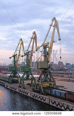 St. Petersburg, Russia - April, 3, 2016: cargo port at sunset in St. Petersburg, Russia