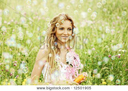 Blonde starts soap bubbles