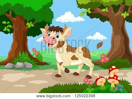 Funny cow with a background of a beautiful garden