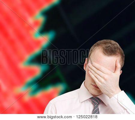 Depressed businessman losing money