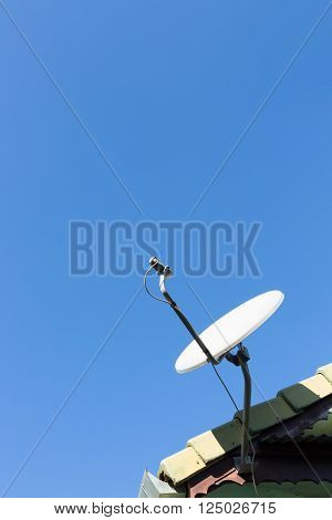 Satellite Dish And Tv Antennas On The House Roof