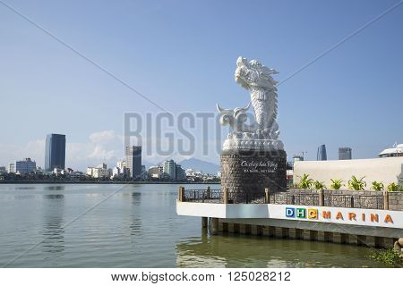 DA NANG, VIETNAM - JANUARY 06, 2016: The sculpture of the dragon on the background of the Han river on a sunny day. The landmark of Da Nang, Vietnam