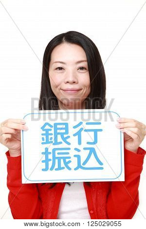 woman holding a message board with the phrase BANK TRANSFER in KANJI