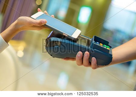 Woman use of mobile phone to pay