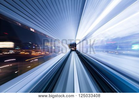 Light trail accelerating through a tunnel
