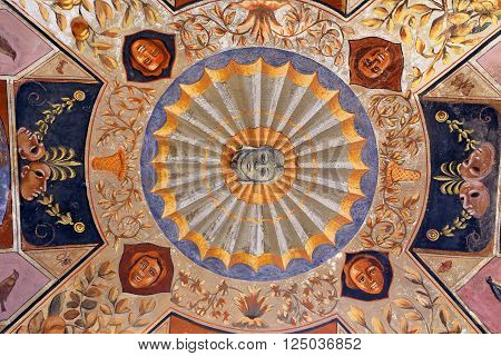 SIENA, ITALY - MARCH 12, 2016: Siena - ceiling in arches of the Palazzo Chigi Saracini courtyard