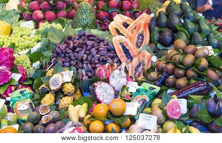 SPAIN, BARCELONA, JUNE, 28, 2015 - La Boqueria market with vegetables and fruits in Barcelona, Spain. La  Boqueria market, Europe's largest and most famous food markets, Barcelona, Spain