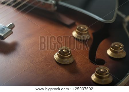 Close up of a classical hollow body jazz guitar