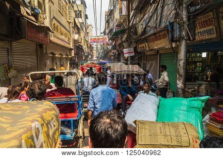 DELHI INDIA - 19TH MARCH 2016: Bad congestion down a street in Delhi. People Tuk Tuks and buildings can be seen.
