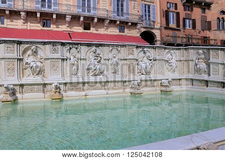 SIENA, ITALY - MASRCH 12, 2016: Fountain of joy - a medieval marble fountain in Siena. Panel Fonte Gaia, Piazza del Campo, Siena, Tuscany, Italy