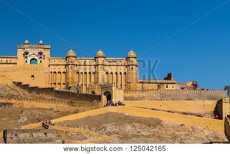 JAIPUR INDIA - 22ND MARCH 2016: The outside of the Amber Fort in Jaipur Rajasthan India. Elephants and people can be seen.