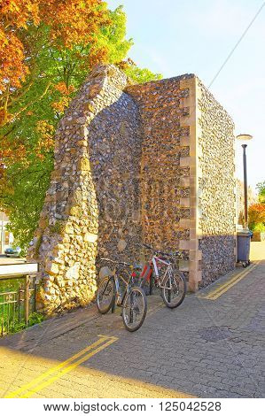 Bicycles at Canterbury City Walls in Canterbury in Kent of England. These walls are defensive ones made of stone and built by the Romans.