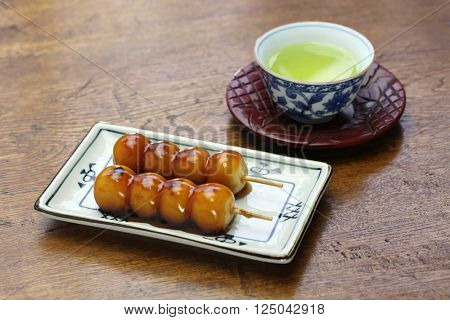 mitarashi dango, skewered rice dumplings covered with sweet soy sauce glaze, japanese dessert