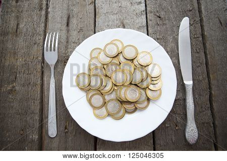 Coins On A Plate