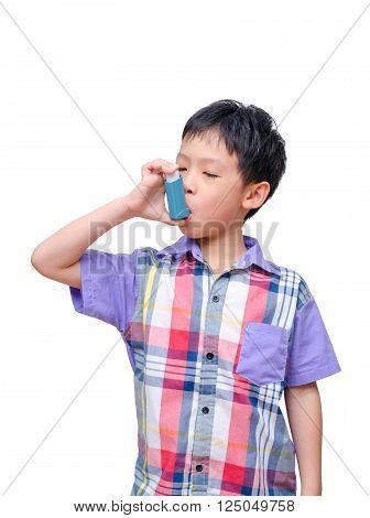 Sick Asian boy using inhaler over white background