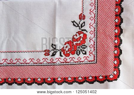 Tablecloth with embroidered flower and decorative ornament
