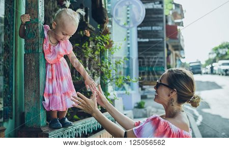 Portrait Of A Woman And Little Girl Walking With Shopping Bags