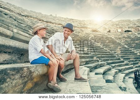 Father and son spent time together on antique ruins amphitheater SideTurkey