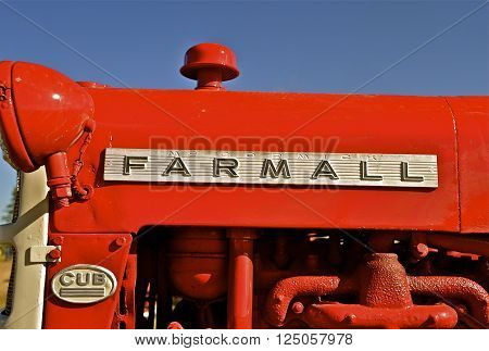 ROLLAG, MINNESOTA, September 1, 2013: A restored Farmall Cub tractor later became Internation Harvester(IH) and then Case International.