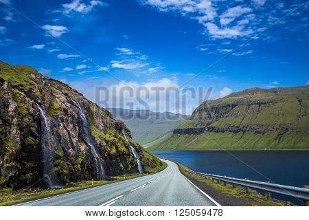 Numerous waterfalls on the hillside, Faroe Islands.