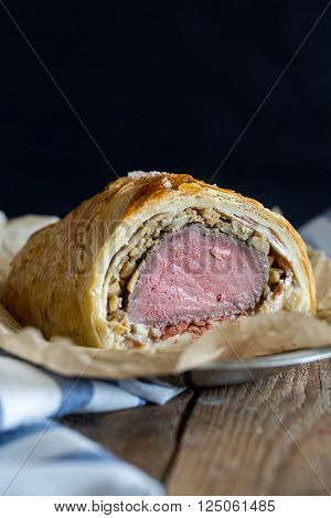 Beef Wellington on a food paper. selective focus ** Note: Shallow depth of field