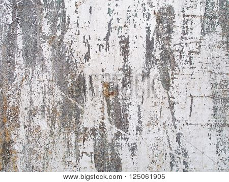 Peeling paint and rust texture. Weathered metal abstract texture. Rusty iron surface. Grunge background. Old dirty rusty steel background. Cracked paint on the wall