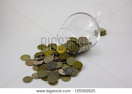 ruble coins in are glass cup on white background